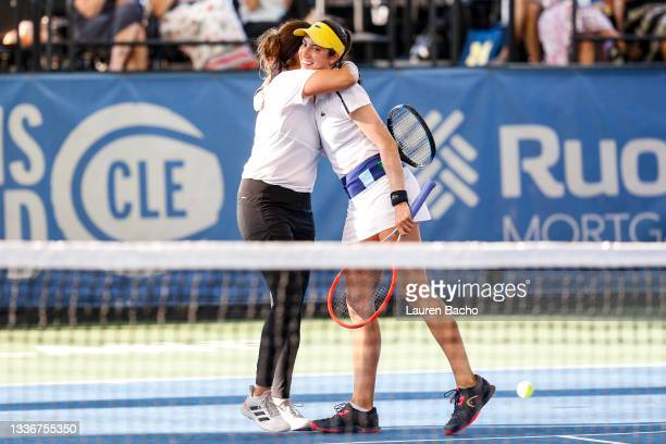 Sania Mirza of India and Christina McHale of the United States hug after winning in the second set of their semifinal doubles match against Ulrikke...