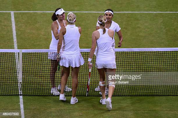 Sania Mirza of India and Martina Hingis of Switzerland celebrate at the net after winning the Final Of The Ladies' Doubles against Ekaterina Makarova...
