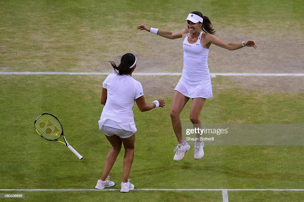 Sania Mirza of India and Martina Hingis of Switzerland celebrate after winning the Final Of The Ladies' Doubles against Ekaterina Makarova of Russia and Elena Vesnina of Russia during day twelve of the Wimbledon Lawn Tennis Championships at the All England Lawn Tennis and Croquet Club on July 11, 2015 in London, England.
