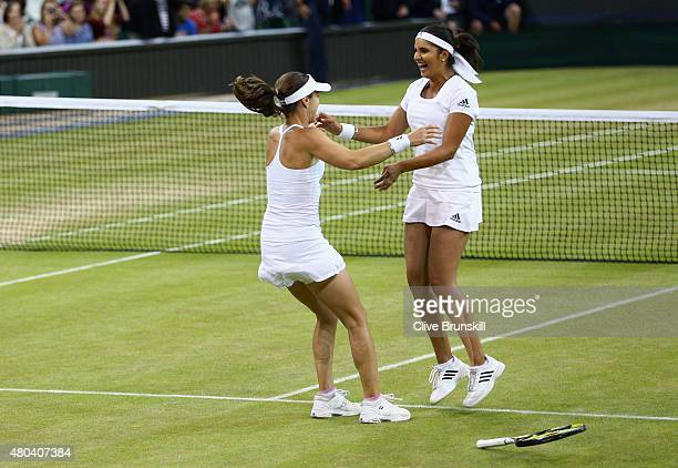 Sania Mirza of India and Martina Hingis of Switzerland celebrate after winning the Final Of The Ladies' Doubles against Ekaterina Makarova of Russia...