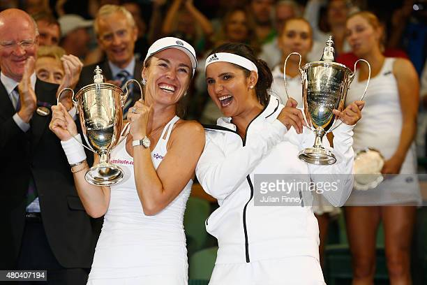 Sania Mirza of India and Martina Hingis of Switzerland celebrate with the trophy after winning the Final Of The Ladies' Doubles against Ekaterina...