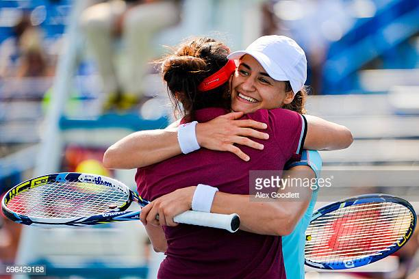 Sania Mirza of India and Monica Niculescu of Romania celebrate after defeating Kateryna Bondarenko of the Ukraine and ChiaJung Chuang of Taipei in...