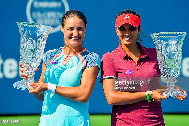 Sania Mirza of India and Monica Niculescu of Romania pose for photos after defeating Kateryna Bondarenko of the Ukraine and ChiaJung Chuang of Taipei...