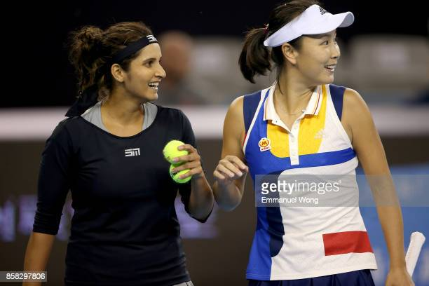 Sania Mirza of India and Shuai Peng of China react during their Women's double quarterfinal match against Katerina Siniakova of Czech Republic and...