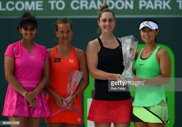 Sania Mirza of India Barbora Strycova of the Czech Republic Gabriela Dabrowski of Canada and Yifan Xu of Canada pose with their trophies following...