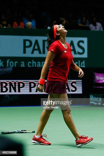 Sania Mirza of India celebrates match point while playing with and Martina Hingis of Switzerland during their doubles finals match against Carla...