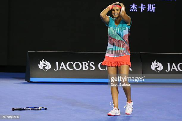 Sania Mirza of India celebrates winning championship point in her women's doubles final match with Martina Hingis of Switzerland against Andrea...