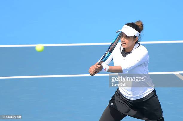Sania Mirza of India hits a backhand during her semi final doubles match against Maria Bouzkova of Czech Republic and Tamara Zidansek of Slovakia...