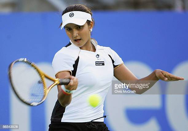 Sania Mirza of India in action against Daniela Hantuchova of Slovakia during play on day two of the Medibank International held at the Sydney...