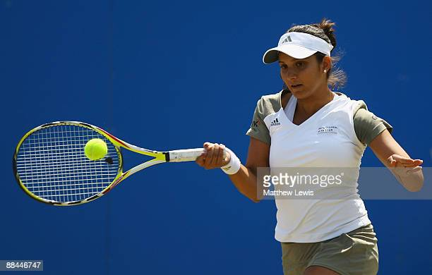 Sania Mirza of India in action against Melinda Czink of Hungary during day five of the AEGON Classic at the Edgbaston Priory Club on June 12 2009 in...
