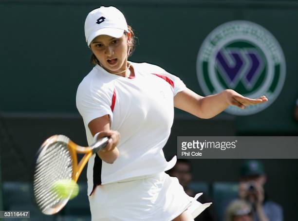 Sania Mirza of India in action against Svetlana Kuznetsova of Russia during the third day of the Wimbledon Lawn Tennis Championship on June 22 2005...