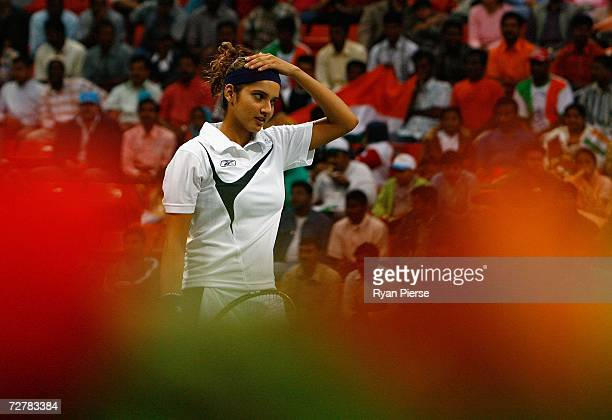 Sania Mirza of India looks on during her First Round Mixed Doubles match with Leander Paes of India against Murad Inoyatov and Dilyara Saidkhodjaeva...