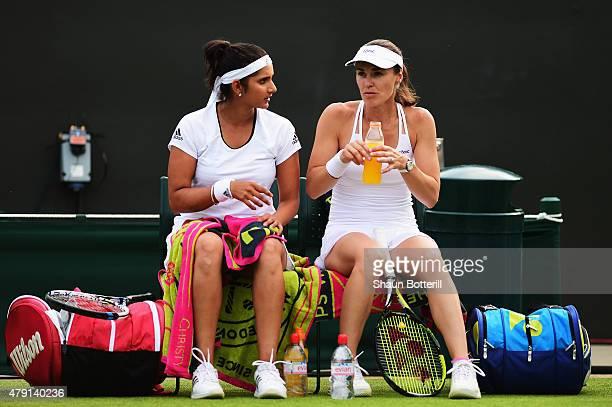 Sania Mirza of India Martina Hingis of Switzerland talk in their Ladies Doubles First Round match against Zarina Diyas of Kazakhstan and Saisai Zheng...