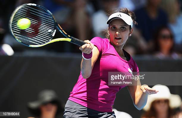 Sania Mirza of India plays a forehand during her match against Sabine Lisicki of Germany during day one of the ASB Classic at ASB Tennis Centre on...