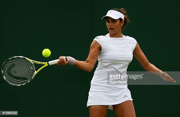 Sania Mirza of India plays a forehand during the women's singles round one match against Catalina Castano of Colombia on day two of the Wimbledon...