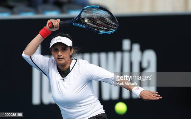 Sania Mirza of India plays a forehand during their semi final doubles match against Maria Bouzkova of Czech Republic and Tamara Zidansek of Slovakia...
