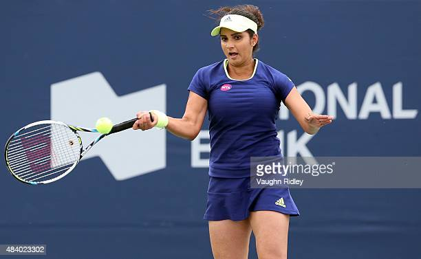 Sania Mirza of India plays a shot against HaoChing Chan and YungJan Chan of Chinese Taipei in a doubles match with partner Martina Hingis of...