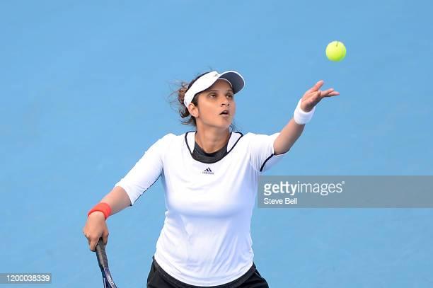 Sania Mirza of India prepares to serve during her semi final doubles match against Maria Bouzkova of Czech Republic and Tamara Zidansek of Slovakia...