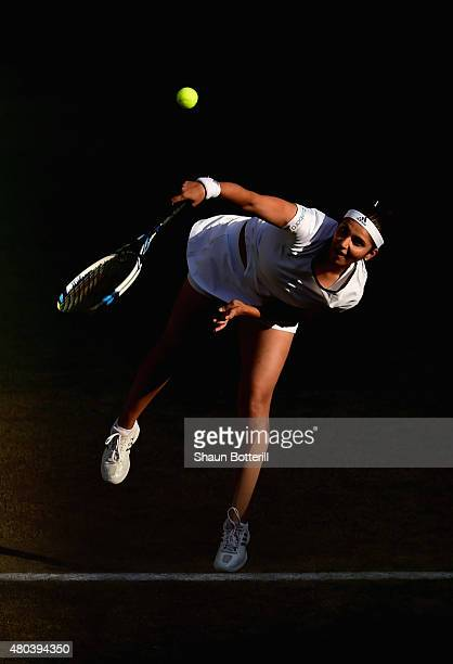 Sania Mirza of India serves playing with Martina Hingis of Switzerland in the Final Of The Ladies' Doubles against Ekaterina Makarova of Russia and...