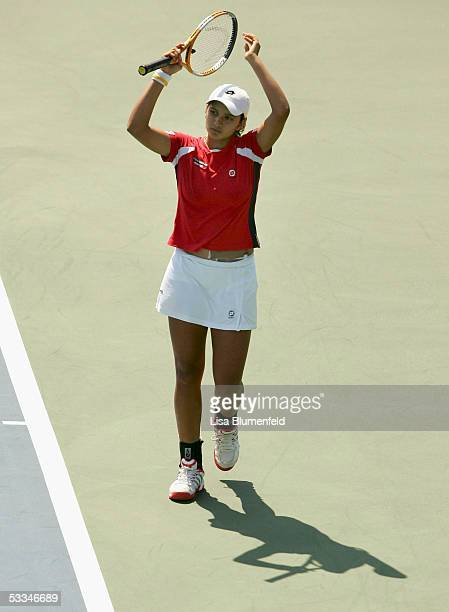Sania Mirza of India throws her hands in the air in frustration after her loss to Iveta Benesova of the Czech Republic during the JP Morgan Chase...