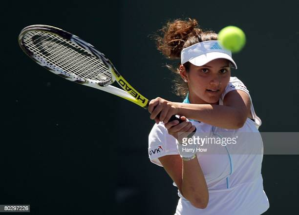 Sania Mirza of India watches her backhand in her match against Daniela Hantuchova of Slovakia during the Pacific Life Open at the Indian Wells Tennis...