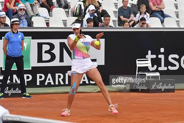 Sania Mirza returns the ball Ekterina Makarova and Elena Vesnina of Russia during the Women's Doubles Final during the WTA Tennis Open tournament...