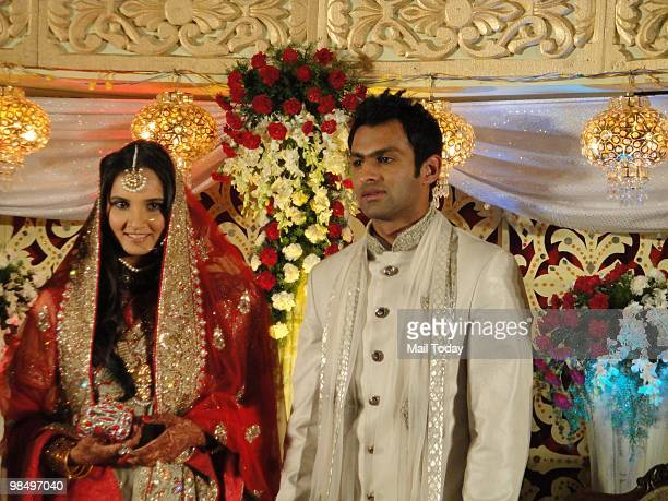Sania Mirza with husband Shoaib Malik at her wedding reception in Hyderabad on April 15 2010