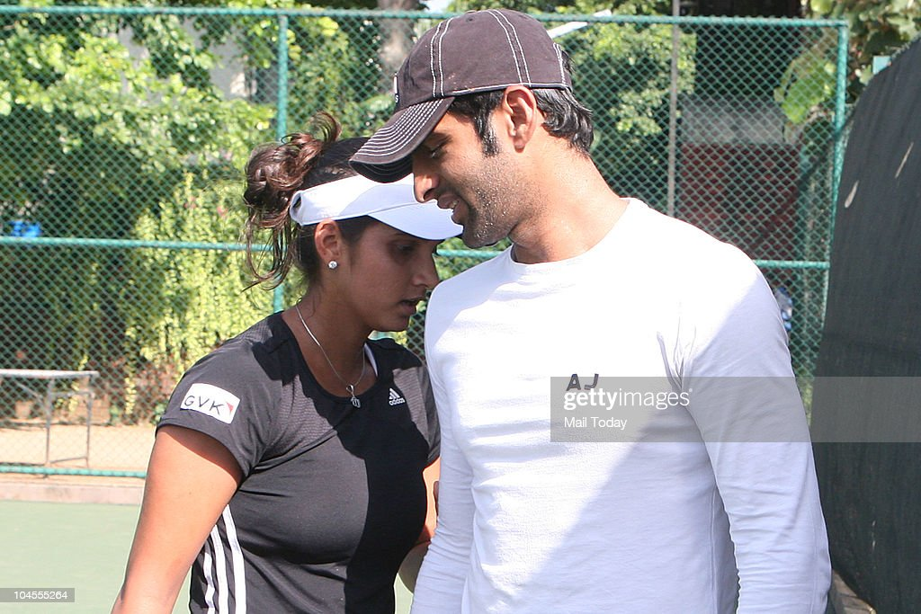 Sania Mirza with husband Shoaib Malik at the Panchsheel Club in New Delhi on September 28, 2010.