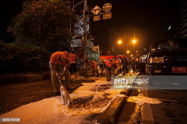 Sanitary agency clean up the blood after the scene of a bomb blast at a police post on a traffic island on J1 Thamrin6 Indonesian authorities believe...