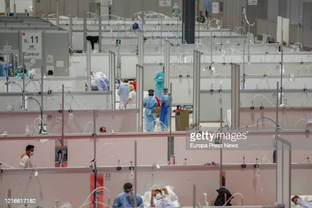 Sanitary are seen working at the campaign hospital of IFEMA established to help during the infection admitting coronavirus patients on April 03 2020...