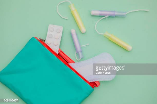 sanitary  bag and sanitary pad background in turqoise colorful background - menstruation gesundheitswesen und medizin stock-fotos und bilder