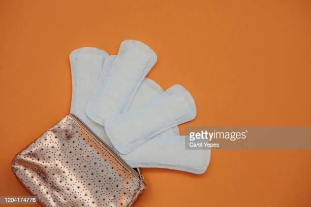 sanitary pad background in  orange background - feminidade - fotografias e filmes do acervo