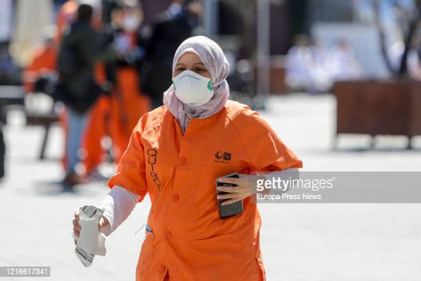 A sanitary worker is seen at the surroundings of the campaign hospital of IFEMA established to help during the infection admitting coronavirus...