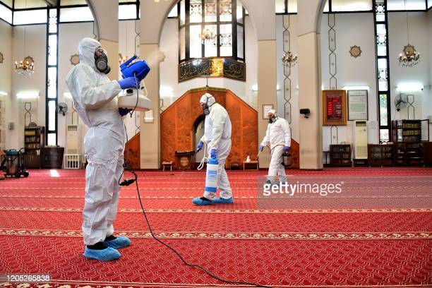 Sanitary workers disinfect a mosque in Beirut on March 5, 2020. - Lebanon's health minister said hospitals were ready to deal with any further spread...