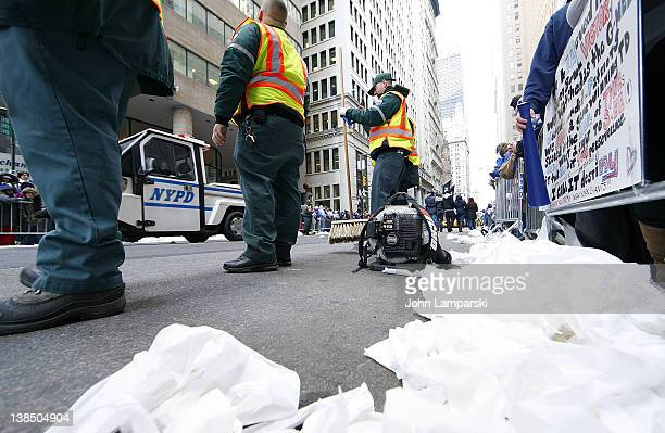 Sanitation Department workers prepare for the cleanup at the New York Giants Victory Parade following their Super Bowl XLVI win down the Canyon of...
