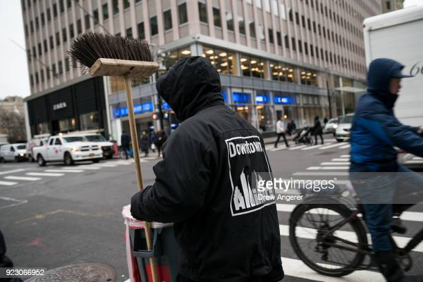 A sanitation worker for Downtown Alliance carries his cleaning supplies through Lower Manhattan February 22 2018 in New York City Using data from...
