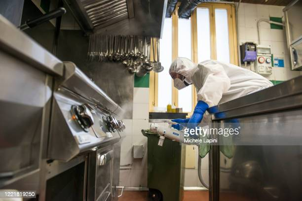 Sanitization measures are carried out in a restaurant kitchen in order to conform with the rules regarding the reopening of economic activity on...