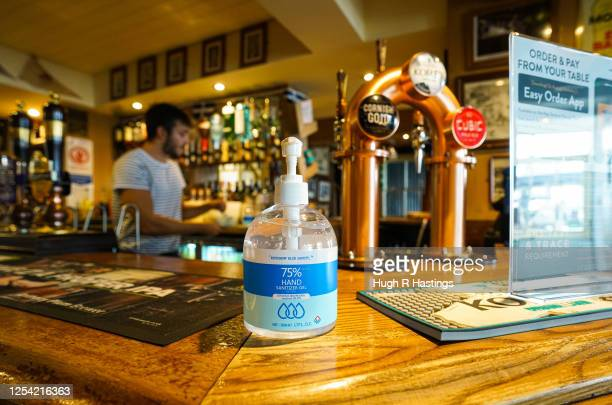 Sanitizer gel dispenser sits on the bar at the Chain Locker pub as it reopens for business on July 4 2020 in Falmouth Cornwall United Kingdom The UK...
