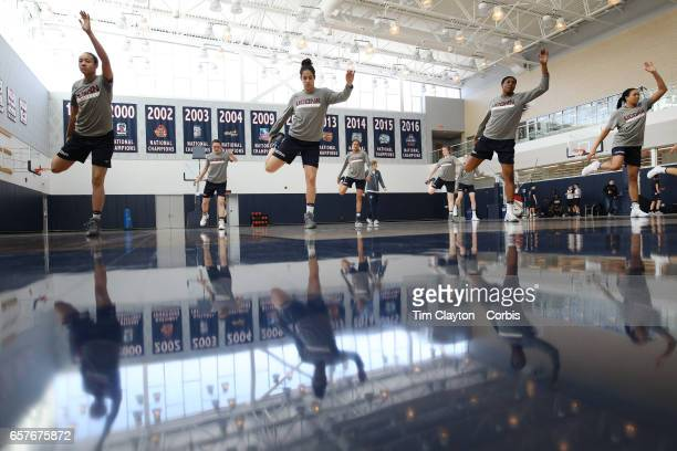 Saniya Chong Kia Nurse Batouly Camara and Napheesa Collier of the UConn Huskies warming up with teammates under the supervision of strength coach...