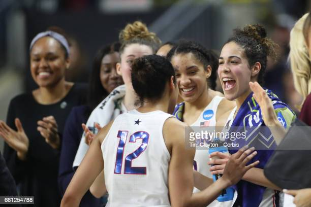 Saniya Chong of the Connecticut Huskies is congratulated by Kia Nurse of the Connecticut Huskies and her teammates as she returns to the bench during...