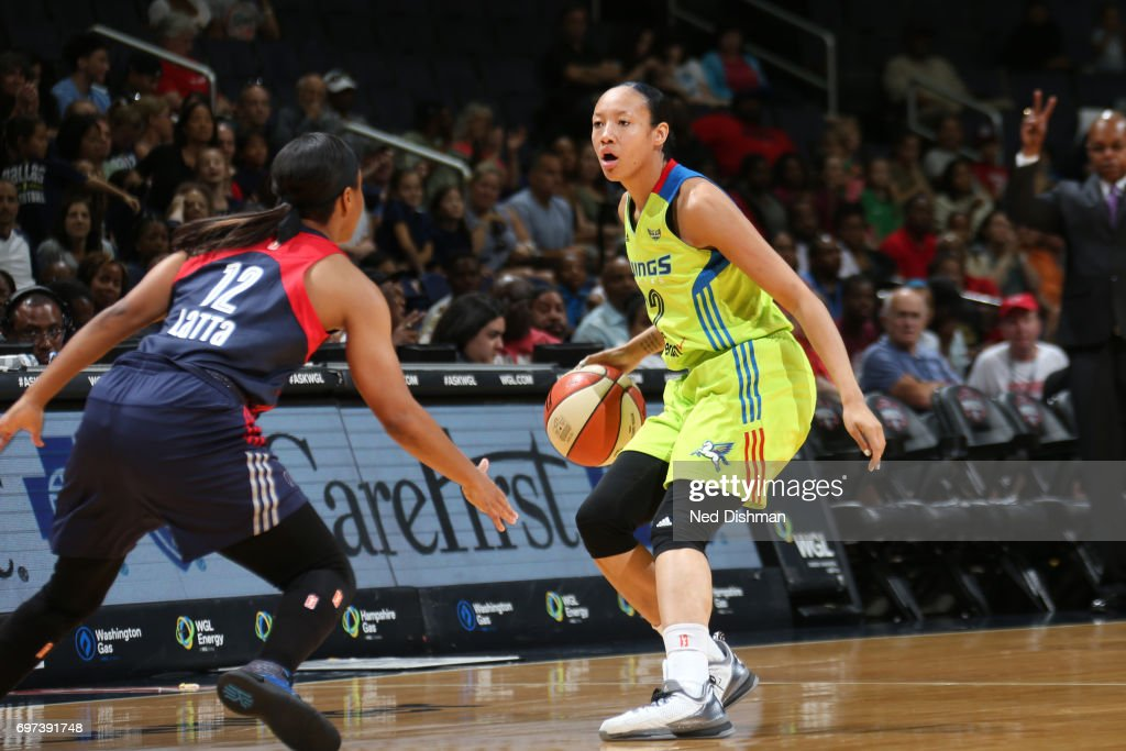 Saniya Chong #12 of the Dallas Wings handles the ball during a game against the Washington Mystics on June 18, 2017 at the Verizon Center in Washington, DC.