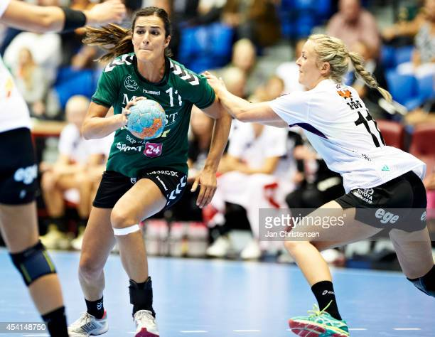 Sanja Damnjanovic of Viborg HK challenge for the ball during the Super Cup Final between Viborg HK and FC Midtjylland in Gigantium on August 22 2014...