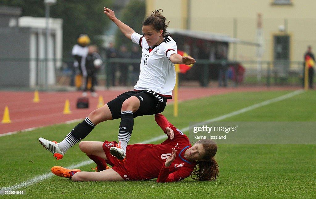 Sanja Homann of Germany is challenged by Viktorie Suchankova of Czech Republic during the International Friendly match between U15 Girls Germany and U15 Girls Czech Republic at Auenstadion on May 24, 2016 in Floeha, Germany.