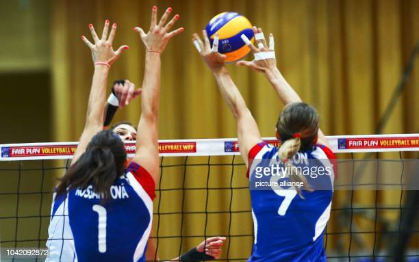 Sanja Malagurski of Serbia in action against Andrea Kossanyiova and Michaela Monzoni of Czech Republic during their women's CEV Volleyball European...