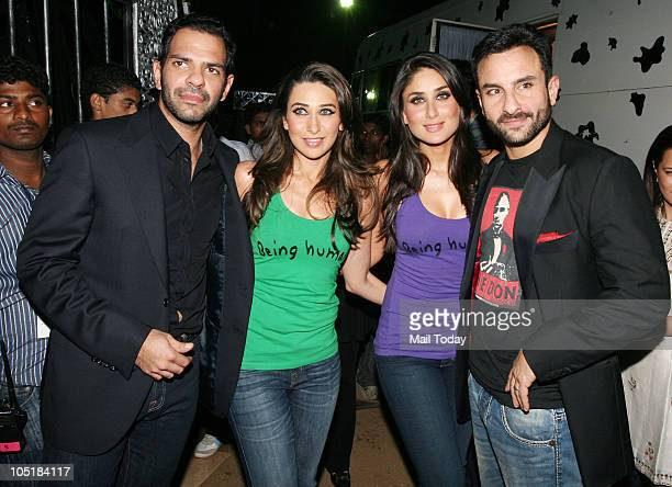 Sanjay and Karisma Kapoor Kareena Kapoor and Saif Ali Khan during the Being Human foundation show at day four of the HDIL Couture week in Mumbai on...
