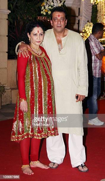 Sanjay and Maanyata Dutt during 'Mata Ki Chowki' function at their house in Mumbai on October 13 2010