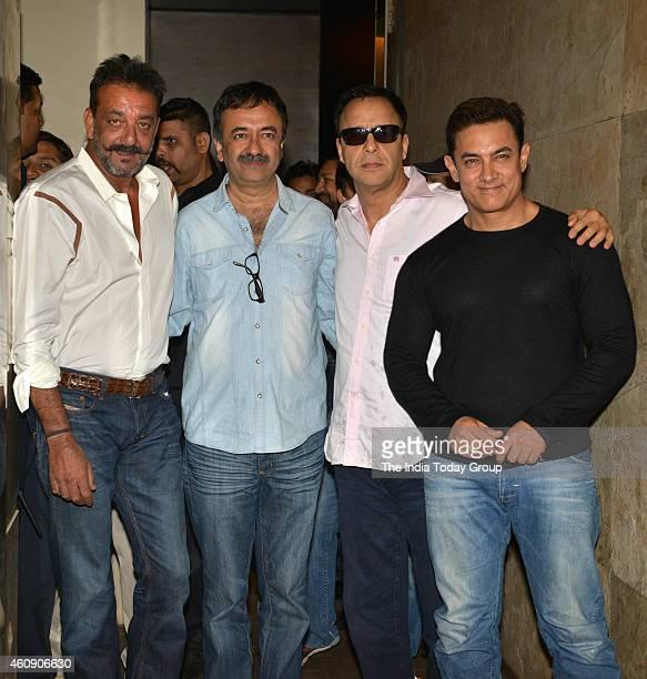 Sanjay Dutt Aamir Khan Vidhu Vinod Chopra and Raju Hirani at the special screening of film PK in Mumbai
