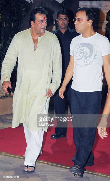 Sanjay Dutt and Vidhu Vinod Chopra during 'Mata Ki Chowki' function at Sanjay Dutt's house in Mumbai on October 13 2010