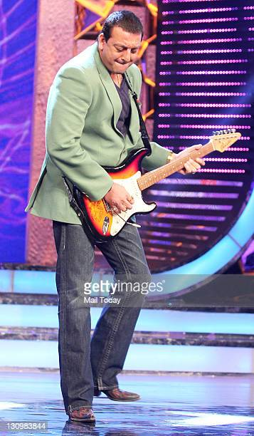 Sanjay Dutt tries his hand on a guitar as Actor Ranbir Kapoor arrives on the sets of Bigg Boss to promote his upcoming film 'Rockstar'