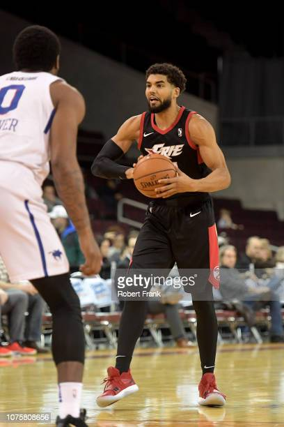 Sanjay Lumpkin of the Erie BayHawks passes the ball at the top of the key against Cameron Oliver of the Delaware Blue Coats during an NBA GLeague...
